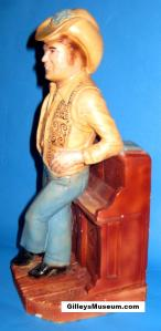 Mickey Gilley chalk ware statue side view.